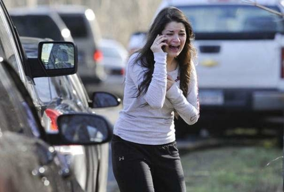A woman waits to hear about her sister, a teacher, following a shooting at the Sandy Hook Elementary School in Newtown, Conn., about 60 miles (96 kilometers) northeast of New York City, Friday, Dec. 14, 2012. An official with knowledge of Friday's shooting said 27 people were dead, including 18 children. It was the worst school shooting in the country's history. (AP Photo/Jessica Hill)